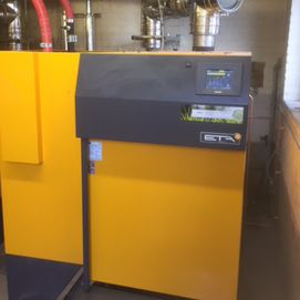 a control panel on a yellow biomass boiler